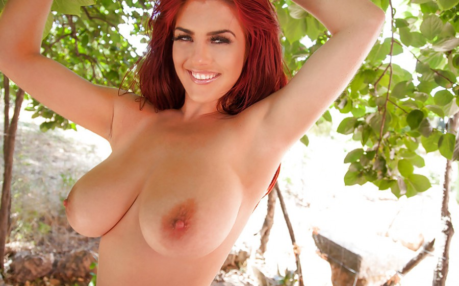 Amazing redhead with big natural tits